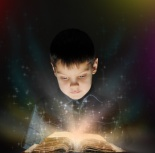 Boy is reading a magic book